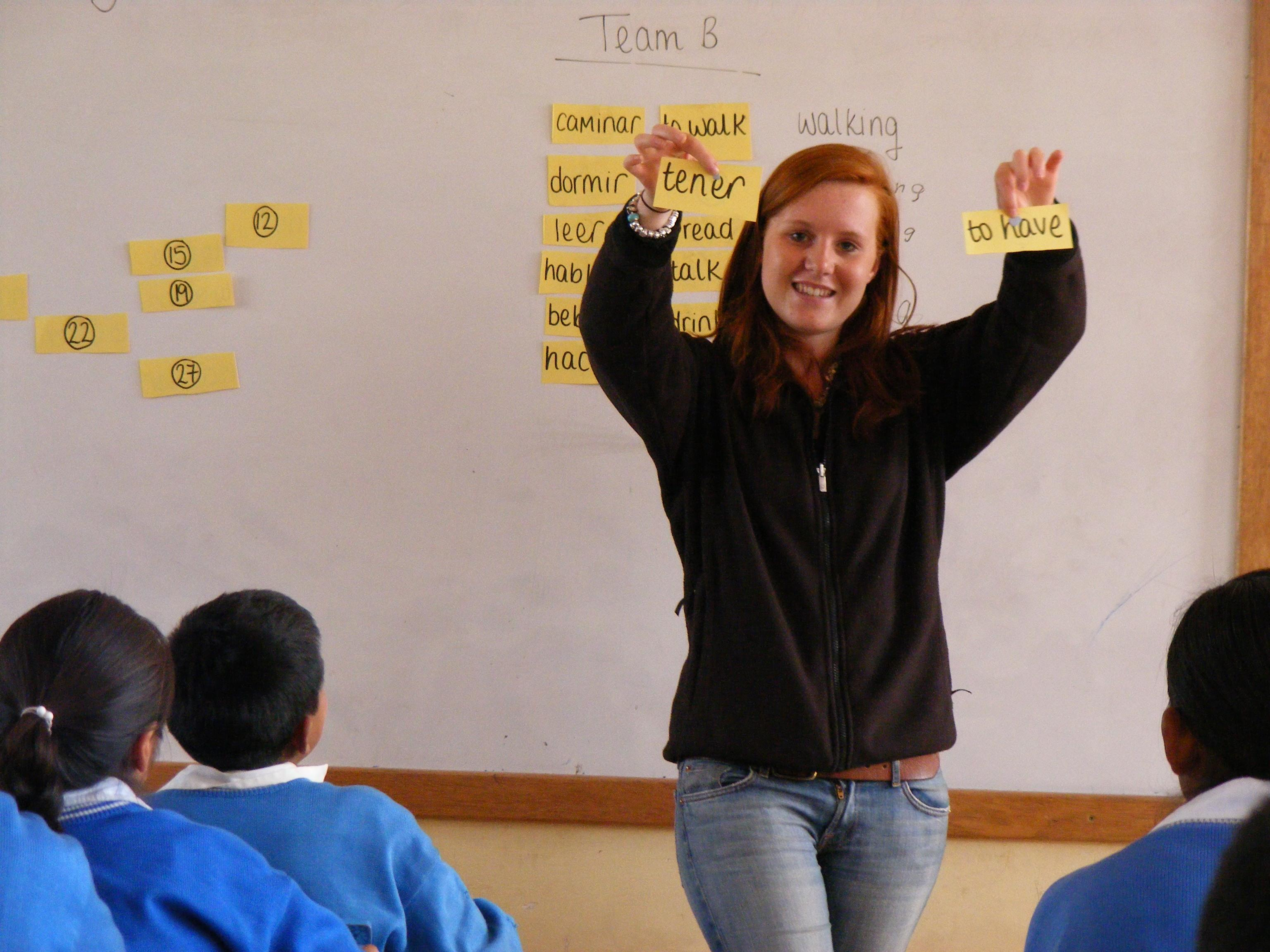 On the Spanish Language Course in Peru, a student also volunteers at a local school, helping with English lessons.